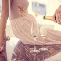 man pouring wine, Valentine's Day Date Ideas