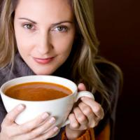 winter soup recipes - woman holding soup bowl